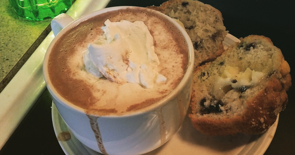 Hot chocolate with blueberry muffin.