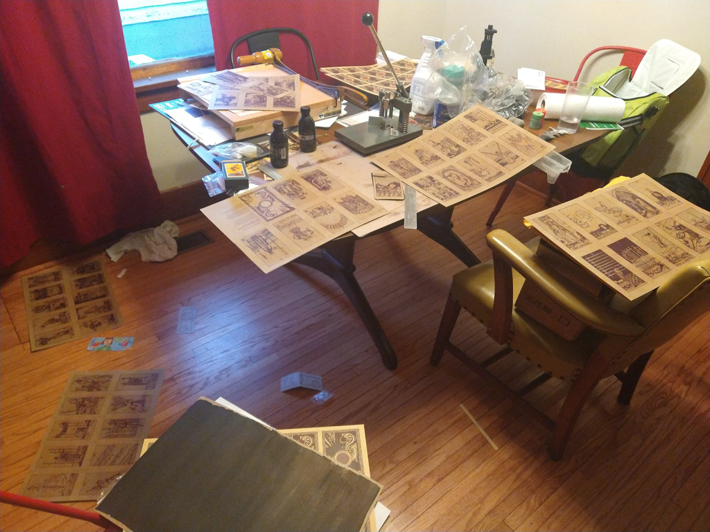 Dining room table overrun by card making materials